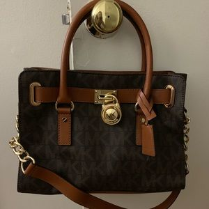 Brown and gold Michael Kors hand bag